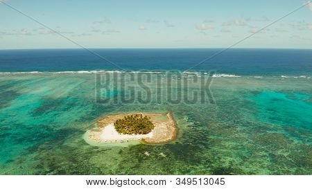 Travel Concept: Sandy Beach On A Small Island By Coral Reef Atoll From Above. Guyam Island, Philippi