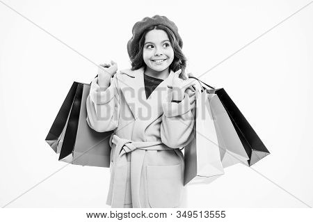 Nice Purchase. Little Shopper. Small Girl With Shopping Bags. Small Child With Paper Bags. Girl Chil
