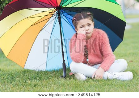 Girl Child Lonely Sad Face Sit Park Under Umbrella. Stay Positive And Optimistic. Colorful Accessory