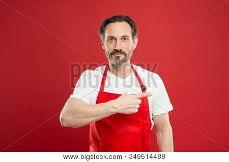 Giving Instructions. Cook With Beard And Mustache Wear Apron Red Background. Man Mature Cook Posing