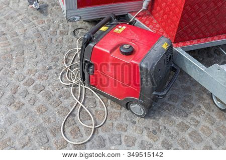 Portable Red Electric Power Generator At Street