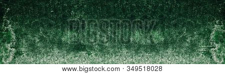 Old Shabby Textured Mossy Concrete Wall. Rough Green Cement Long Texture. Dark Wide Background