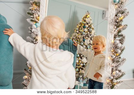 Toddler Standing Smiling To His Reflection I The Mirror