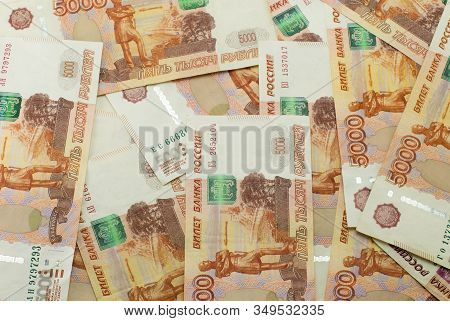 Russian Banknotes 5000 Rubles. Randomly Scattered. Background Made Of Money.
