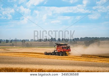 Combine Harvester In Action On The Field. Combine Harvester. Harvesting Machine For Harvesting A Whe