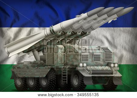 Tactical Short Range Ballistic Missile With Arctic Camouflage On The Lesotho Flag Background. 3d Ill