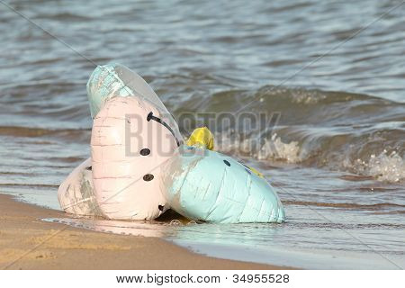 Party Balloons Washed Up on a Beach