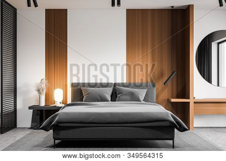 White Bedroom Interior With Round Mirror