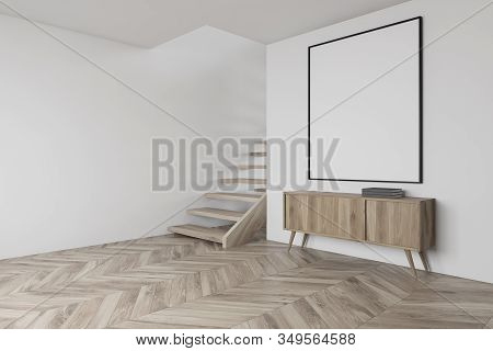 White Living Room Corner With Cabinet And Poster