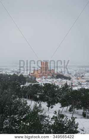 Landscape Of A Snowy Town With A Medieval Castle. Landscapes And Winter Concept