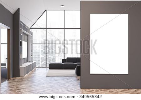 Interior Of Stylish Living Room With Gray Walls, Wooden Floor, Gray Armchair And Sofa Standing Near