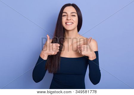 Portrait Of Attractive Beautiful Attractive Young Brunette Standing Isolated Over Lilac Background,