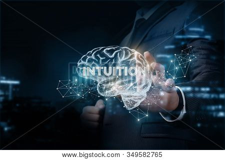 Concept Intuition In Business. Businessman Shows A Brain With The Inscription Intuition.