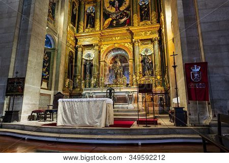 Lisbon - August 28, 2019: Detail Of The Chancel With A Gilded Altar Piece And Representation Of The