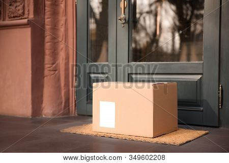 Delivered Parcel On Door Mat Near Entrance