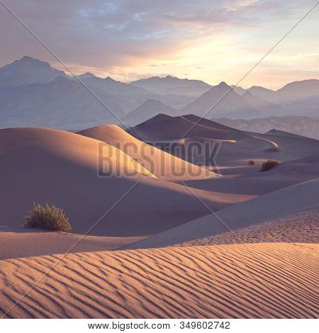 Dunes of Death Valley desert at sunrise.