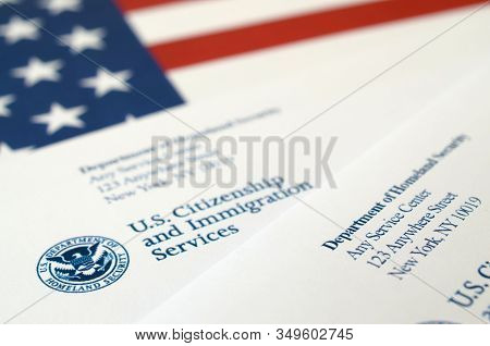 Envelopes With Letter From Uscis On United States Flag From Department Of Homeland Security