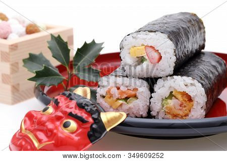 Japanese Traditional Setsubun Event, Masks Of Oni Demon And Ehomaki Sushi Are Used On An Annual Even