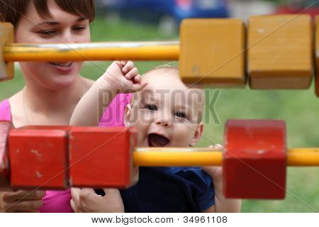 Happy Child Playing With Blocks