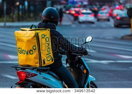 Bucharest, Romania - January 28, 2020: A Glovo Food Delivery Courier Delivers Food In Bucharest, Rom