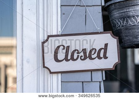 Closed Hanging Door Sign In A Shop.