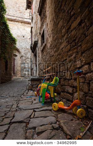 A Street With Children's Toys In Groznjan, Istria, Croatia
