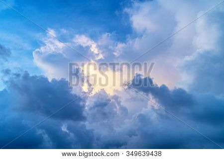 Thick Cumulus Clouds Against A Blue Sky.