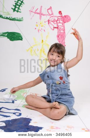 Girl Paints Pictures On Paper