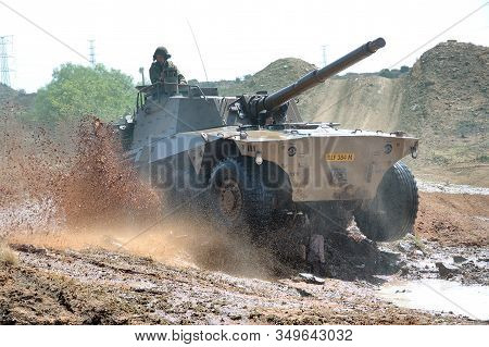 Bloemfontein, South Africa - November 1, 2008: A Rooikat Armoured Reconnaissance Vehicle Driving Thr