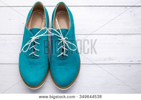 Turquoise Lace-up Women Shoes, Suede Boots Of Aqua Color. Pair Of Footwear On White Wood Background.