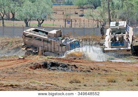 Bloemfontein; South Africa - November 1; 2008: A Casspir Troop Carrier Driving Through Muddy Water A