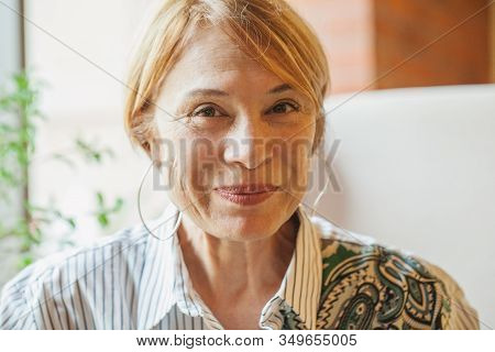 Smiling Older Woman With Short Ginger Hair Portrait