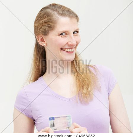 Smiling Blonde Woman With Her Id Card