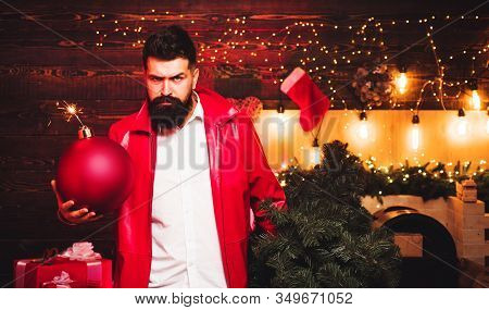 Christmas Man In Fashion Red Dress Hold Bomb. Creative Boom. Hipster Santa Claus. Bomb Text Copy Spa