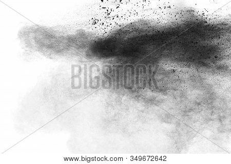 Black Particles Splatter On White Background. Black Powder Dust Burst.