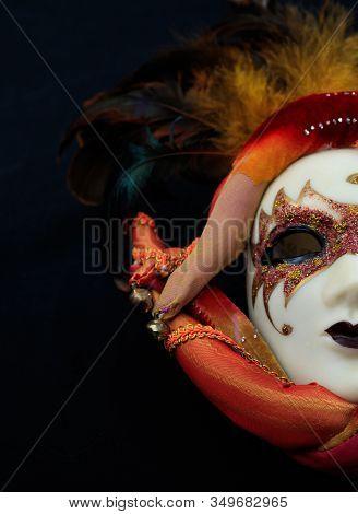 Carnival Mask Female Theatrical Face Against Black Background. Festive Party Celebration