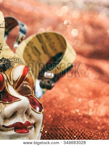 Carnival Mask Female Theatrical Face Against Bokeh Background. Festive Party Celebration
