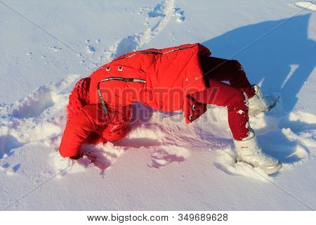 The Child Plays Sports In The Snow
