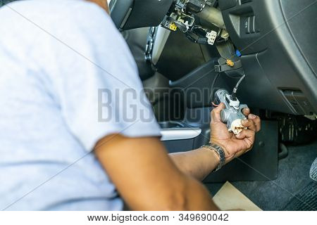 Close Up Hand Of Technician During Hold For Repair Key Or Switch Engine Start Of Sedan Car
