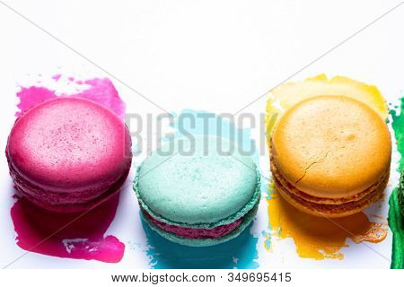 Bright Colorful Macaroons On White Painted Background. Blue, Yellow And Green Macaroons. Variety Of