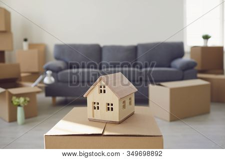 Model Of The House On The Floor In The New Bright Sunny House.
