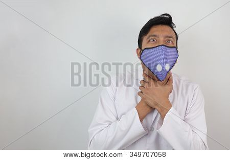 A Male Doctor In Mask And White Coat Holding His Neck With Both Hands With Choking Expression Isolat