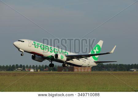Amsterdam, The Netherlands  -  June 2nd, 2017: Ph-hxe Transavia Boeing 737 Taking Off From Polderbaa