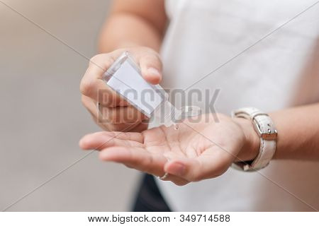 Woman Hands Using Wash Hand Sanitizer Gel Dispenser, Against Novel Coronavirus (2019-ncov) Or Wuhan