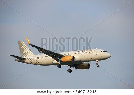 Amsterdam, The Netherlands - June 22nd 2017: Ec-lzf Vueling Airbus A320 Approaching Polderbaan Runwa