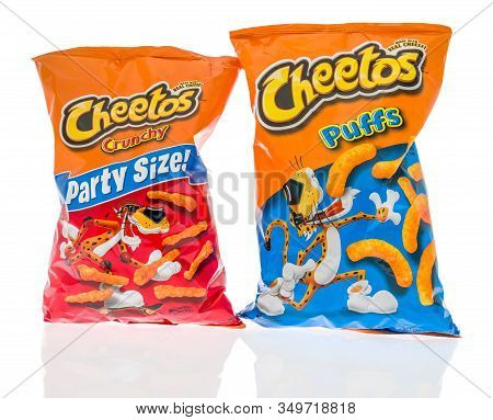 Winneconne,  Wi - 7 February 2020:  A Package Of Cheetos Crunchy And Puffs  Cheddar On An Isolated B