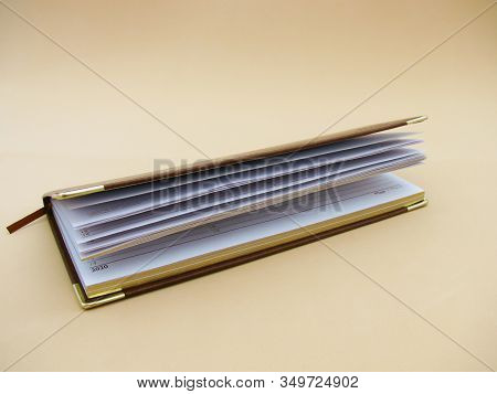 brown planning for 2020 on a beige background. dated diary. notepad.