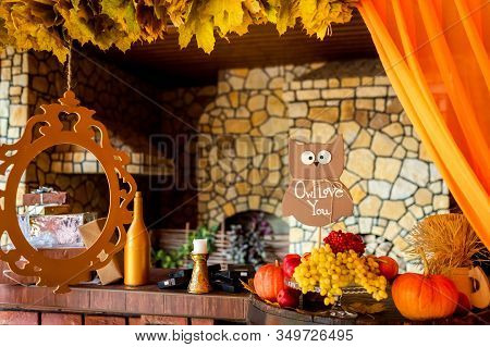 Beautiful Autumn Composition With Pumpkins And Leaves Near Wooden Wall. Photozone.