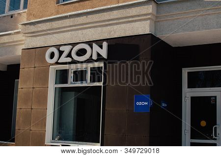 Moscow, Russia - December 8, 2019: Courier Hands Holding Ozon Online Retailer Parcel. Ozon Is The Ru