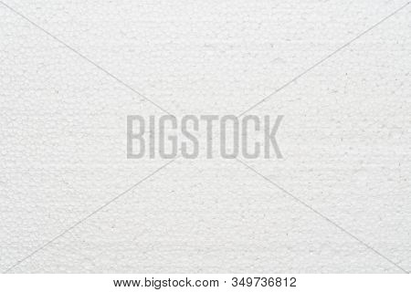 White Abstract Polystyrene Foam Texture Background. Close-up Detail View Of Styrofoam, Plastic Sheet